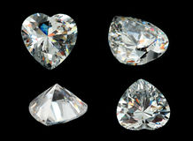 Vier gemmen van de hartvorm die op een zwarte worden geïsoleerdd Royalty-vrije Stock Foto