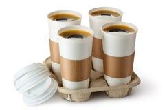 Vier geopende meeneemkoffie in houder Stock Afbeeldingen