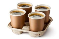 Vier geopende meeneemkoffie in houder Stock Afbeelding