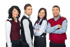 Vier Geschäftsleute in einer Reihe Stockfotos