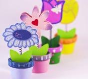 Vier geschilderde decoratieve bloemen royalty-vrije stock afbeelding