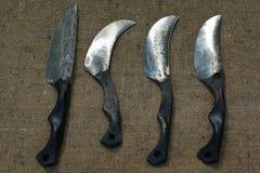 Vier gesmeed mes bij het ontslaan. stock foto