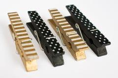 Vier Gouden en Zwarte Wasknijpers met Perspectief V van Pretpatronen Royalty-vrije Stock Foto