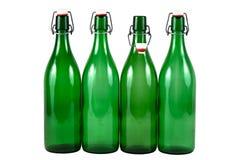 Vier groene flessen Stock Afbeelding