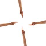 Vier Hände, die auf Mitte zeigen Lizenzfreie Stockbilder