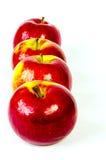 Vier hübsche Äpfel Lizenzfreie Stockfotografie