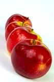 Vier hübsche Äpfel Lizenzfreies Stockbild