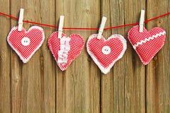Vier hand-genähte Herzen Lizenzfreies Stockfoto
