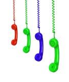 Vier het gekleurde telefoons hangen Royalty-vrije Stock Afbeeldingen