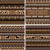 Vier Hintergründe mit afrikanischen Motiven und Tieren Stockbilder
