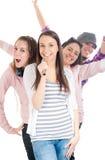Vier jonge mensen die pret hebben stock foto's