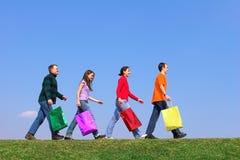Vier jonge mensen met kleur p Royalty-vrije Stock Foto's