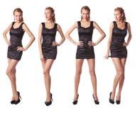 Vier jonge vrouwen in zwarte kledings volledige lengte Stock Afbeeldingen