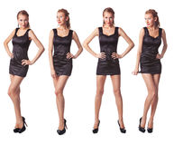 Vier junge Frauen im schwarzen Kleid in voller Länge Stockbilder
