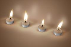 Vier kaarsen op bruine achtergrond Stock Foto