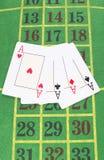 Vier Karten schürhaken Stockbild