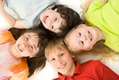 Vier kinderen Stock Afbeeldingen