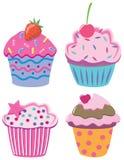 Vier kleine Kuchen Lizenzfreie Stockbilder