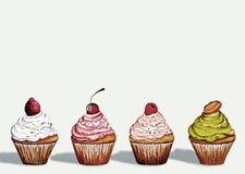 Vier kleine Kuchen Stockfotos