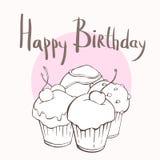 Vier kleine Kuchen, glückliche Glückwunschkarte Stockbilder