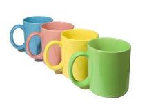 Vier kleurrijke mokken Stock Afbeeldingen