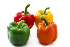 Vier kleurrijke paprika stock fotografie