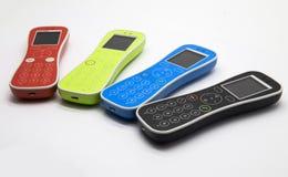 Vier kleurrijke telefoons stock foto