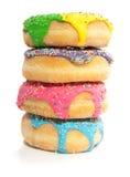 Vier kleurrijke verticale donuts Stock Foto's