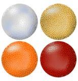 Vier knackten Bälle im Silber, im Gold, in der Orange und im Rot Stockfoto