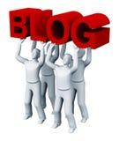 Vier Leute, die einen Blog anhalten Stockfotos