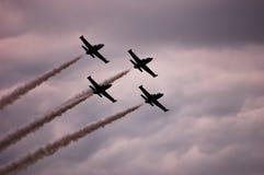 Vier Lufthandwerks-Showkunstfliegen Lizenzfreie Stockfotos