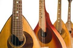 Vier mandolines sluiten omhoog Geïsoleerd op een witte achtergrond royalty-vrije stock afbeelding