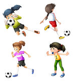 Vier meisjes die voetbal spelen royalty-vrije illustratie