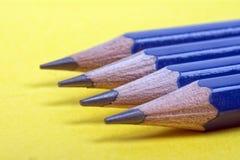 Vier met een riek omgewoelde potloden Royalty-vrije Stock Foto