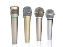 Vier microfoons stock afbeelding
