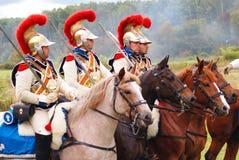 Vier militairen die paarden berijden. Royalty-vrije Stock Fotografie