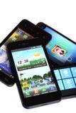 Vier mobiele telefoons Stock Afbeeldingen