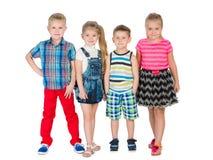 Vier Modeblondinenkinder Stockfoto