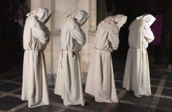 Vier monniken op een rij stock fotografie