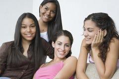 Vier mooie tieners. stock afbeeldingen