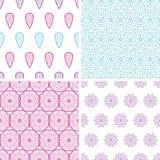 Vier nahtlose Muster der abstrakten Federmotive Stockbilder