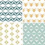 Vier nahtlose Muster der abstrakten Pfeilformen eingestellt Lizenzfreie Stockbilder