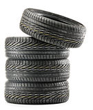 Vier neue schwarze Reifen auf Weiß Stockbild