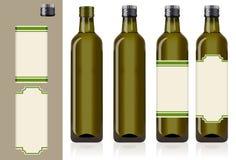 Vier Olivenölflaschen Stockbilder