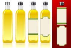 Vier Olivenölflaschen Lizenzfreies Stockbild