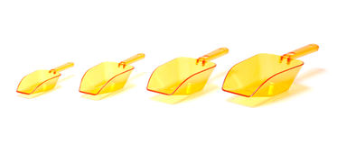 Vier orange transparente Plastikschaufeln Lizenzfreie Stockbilder