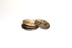 Vier oude muntstukken op witte achtergrond royalty-vrije stock foto