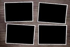 Vier oude uitstekende foto's op houten achtergrond royalty-vrije stock foto's