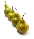 Vier peren op een rij op wit Stock Afbeelding