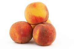 Vier perziken stock foto's